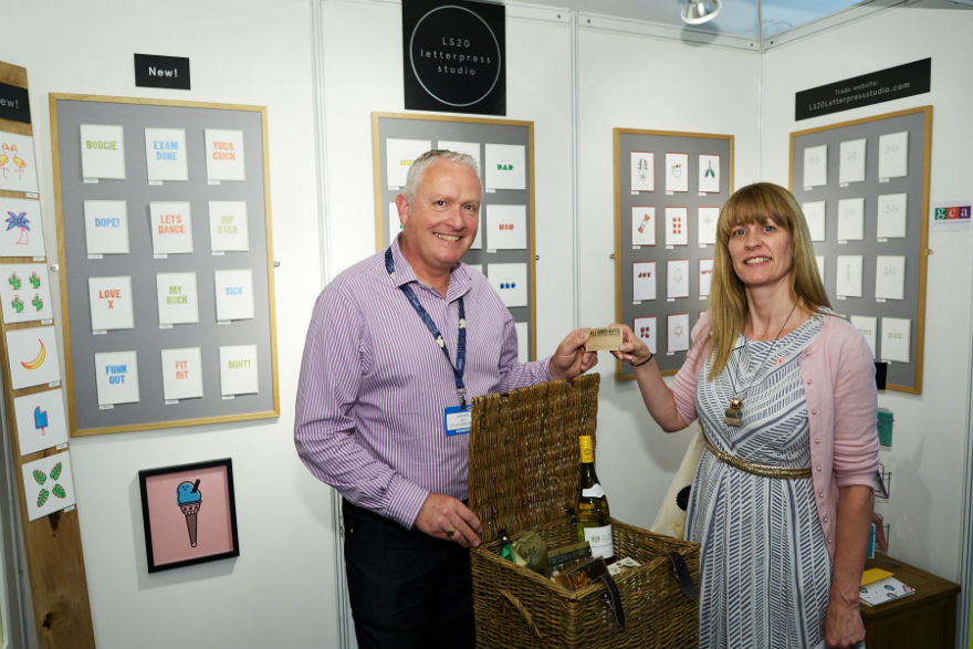 Andrew Davis from LS20 Letterpress Studios and Gale Astley from Progressive make the draw for the winner of the Betty's hamper.